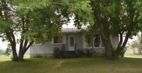 Updated Beauty on .84 Acres Just Waiting for YOU in Leask, SK!