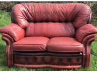 Red leather chesterfield two seater sofa