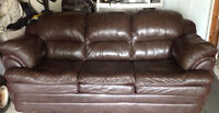 BROWN LEATHER COUCH.      $125