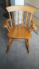 Solid pine rocking chair.