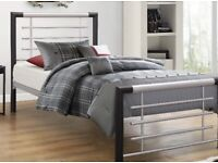 Single black and sliver frame with mattress