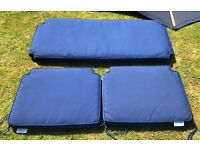 Paul Reef blue parasol and blue seat cushions.