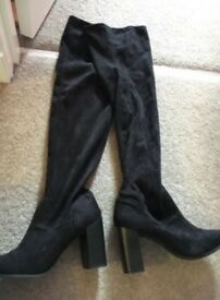 Knee high boots.