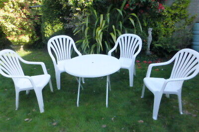 Fold up white plastic garden table with metal legs & 4 white plastic chairs