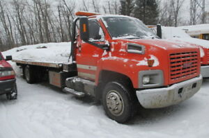 2006 GMC flatbed tow truck