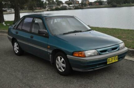 1992 Ford Laser KHII GLi Turquoise 4 Speed Automatic Hatchback