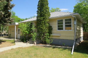 Location, Location.    Southside Bungalow on Huge Lot!