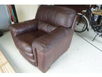 Chocolate Brown Leather Arm Chair & Matching Foot Stool. Excellent Condition. Buyer Collects.