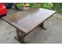 Large solid wood extending dining table.