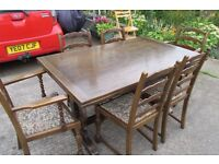 Solid dark wood extending dining table with 6 chairs