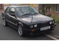 1990 BMW e30 320i SE black, black leathers