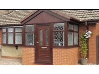 White and brown UPVC Windows Fitted from £399