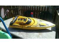 Radio controlled boat is large .broken for parts or repair