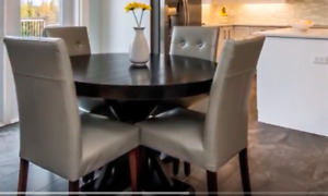Beautiful black dining room table with 4 grey chairs