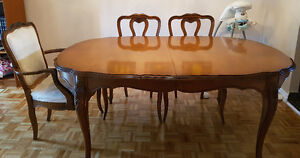 Beautiful large solid wood table with 8 chairs