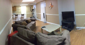 Basement suite/shared main floor 2500 sq ft house in woodlands.