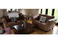 Brown leather 2 seater and 3 seater sofas sold together.