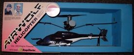 Rare 'Airwolf' Cox flying model helicopter, with other accessories
