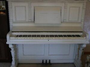 white upright piano