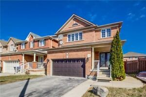 This Immaculate 4 Bdrm, 2410 Sq Ft Detached Home