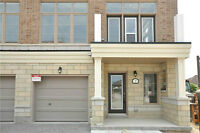 BRAND NEW NEVER LIVED IN END UNIT TOWNHOME IN STOUFFVILLE!