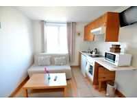 -Good size bright studio flat in Earl's Court, West Cromwell Road