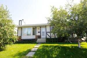 MUST SELL PRICE REDUCED LEDUC HOUSE WITH IN LAW SUITE