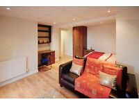 Large studio flat with separate kitchen & bathroom. Heating inc. in rent