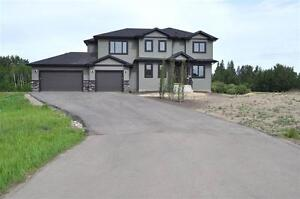 THIS BREATHTAKING CUSTOM BUILT 2-STOREY BACK OUT ONTO A POND!!!