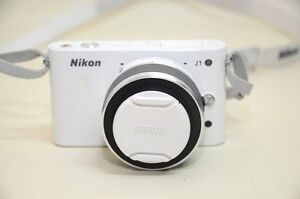 White Nikon J1 with 10-33 mm lens and 32 GB Memory Card + Case