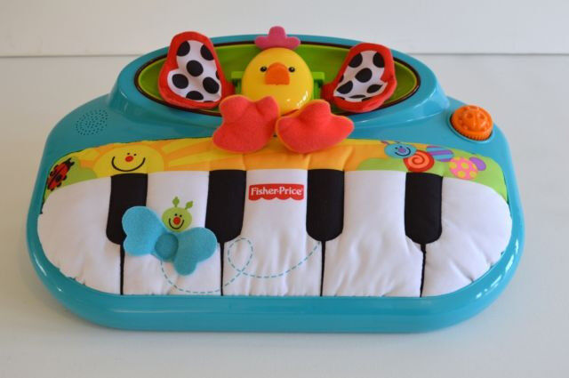 Fisher Price Miracles & Milestones Peek-a-Boo Piano Crib/Floor Toy Lights Music