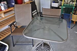 Table, two chairs and umbrella stand