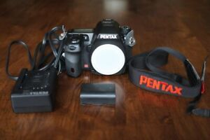 like new pentax K5 dslr body and also, 18 55, 55 200, 55 300
