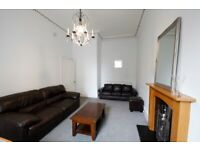 Clean, spacious tenement with great kitchen & many original features. All rooms are large & windowed