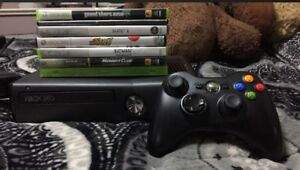 Black Xbox 360 with 8 games in good condition