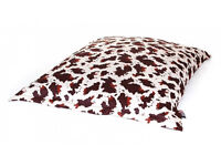 Brand new giant indoor/outdoor beanbag with cow print pattern