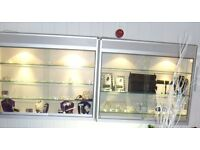 Glass wall shop cabinets with lights