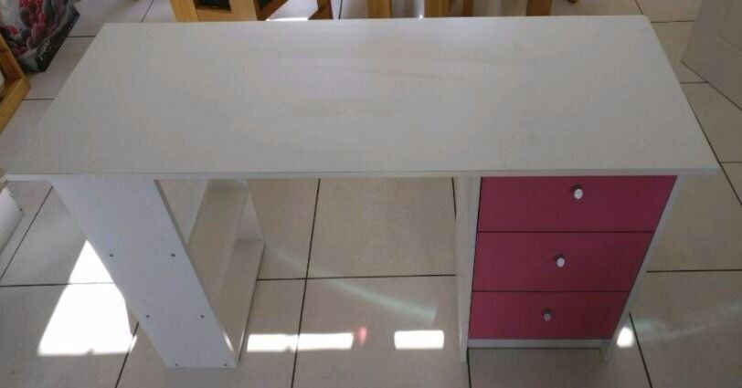 White desk with pink draws