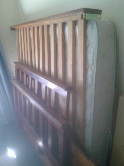 Queen size bed with wooden frame