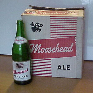 Moosehead pale ale case and old beer bottles