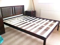 wooden double bed frame with mattress support