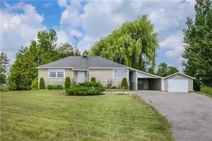 Rural Bungalow With Tons Of Potential on a Lot of 129x331 Feet