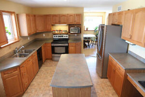 Spacious Country Home and Acreage in Carberry