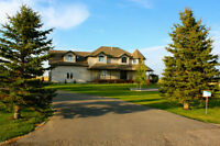 Acreage 1 km from Lethbridge - Priced below Appraisal!
