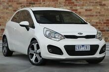 2013 Kia Rio UB MY13 SLS White 6 Speed Manual Hatchback North Melbourne Melbourne City Preview