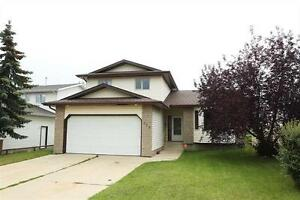 REDUCED!! Spacious Home Backing Onto Park in Charming Millet!