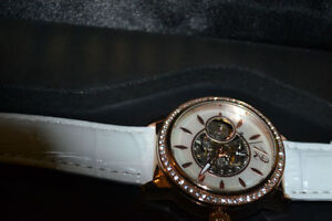 like new sturling automatic watch for ladies (defective)
