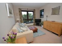 Tasteful 2 bedroom unfurnished 1st floor flat with private garage available December - NO FEES