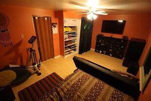 Furnished basement suite with shared kitchen