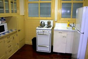 furnished historic suite , hardwood floors , claw foot tub